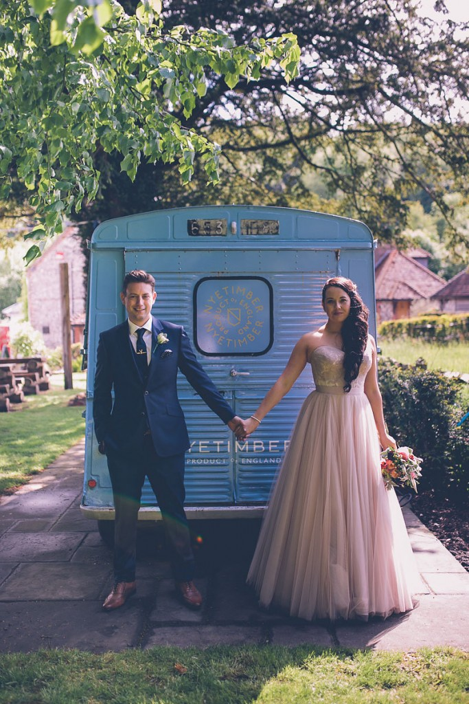 Couple portrait in front of blue van