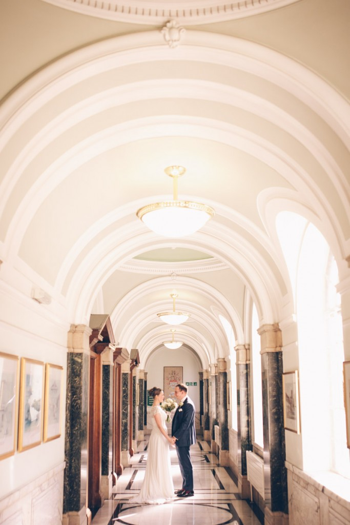 Bride and groom portrait in corridor