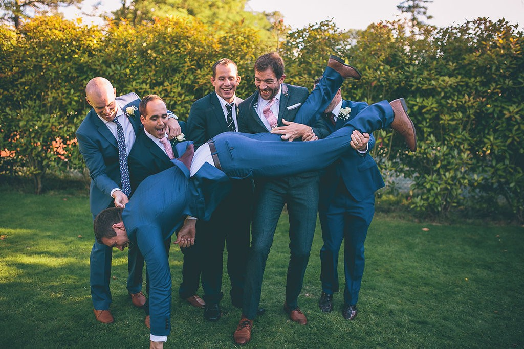 Groom being dropped by friends