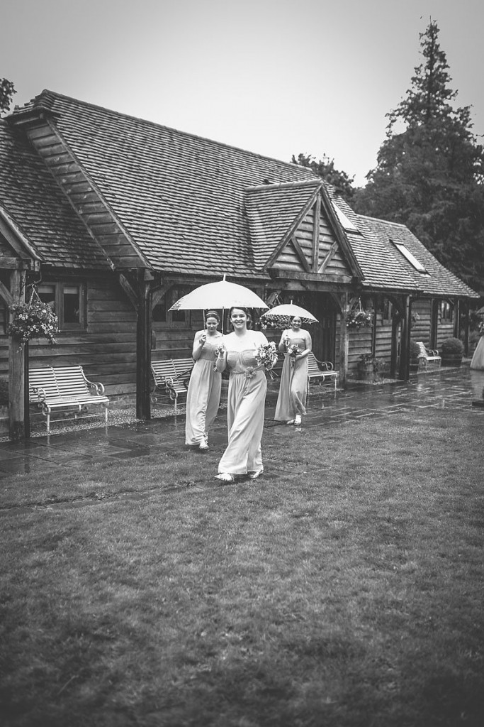 Bridesmaids with umbrellas