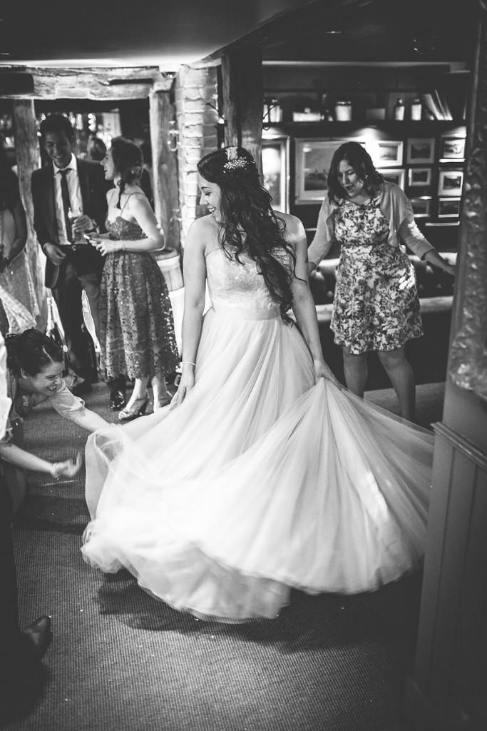 Bride swishing floor length dress