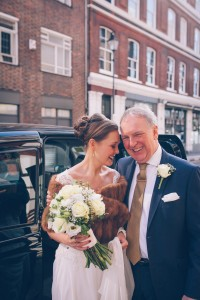 Bride and father of the bride by taxi