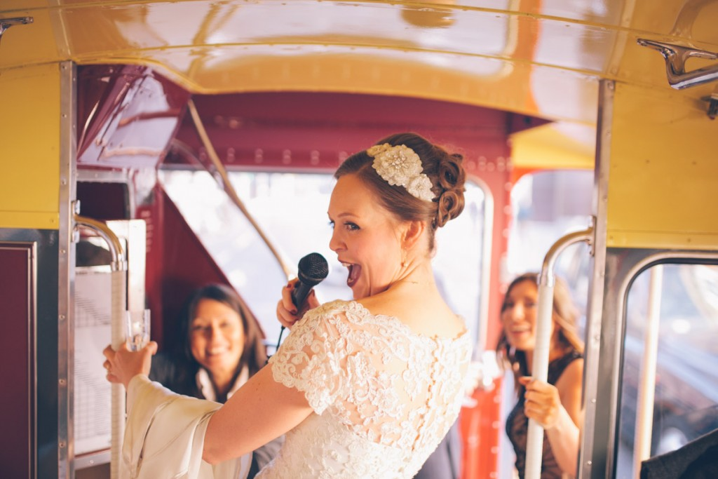 Bride on routemaster with microphone