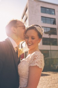Bride and groom laughing with sunflare