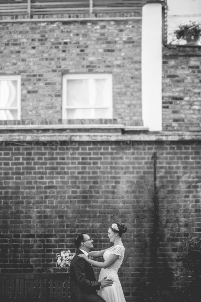 Bride and groom portrait brick wall