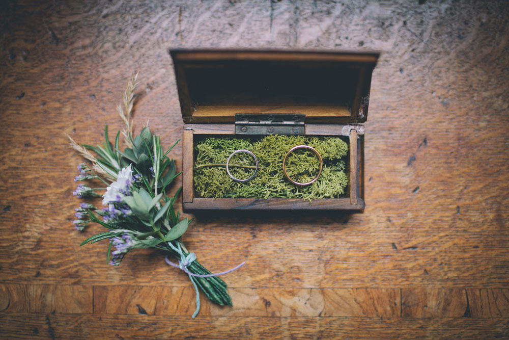 weddings in moss-filled box and button hole