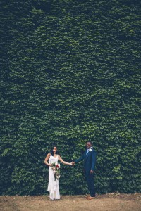 Couple portrait against wall of ivy