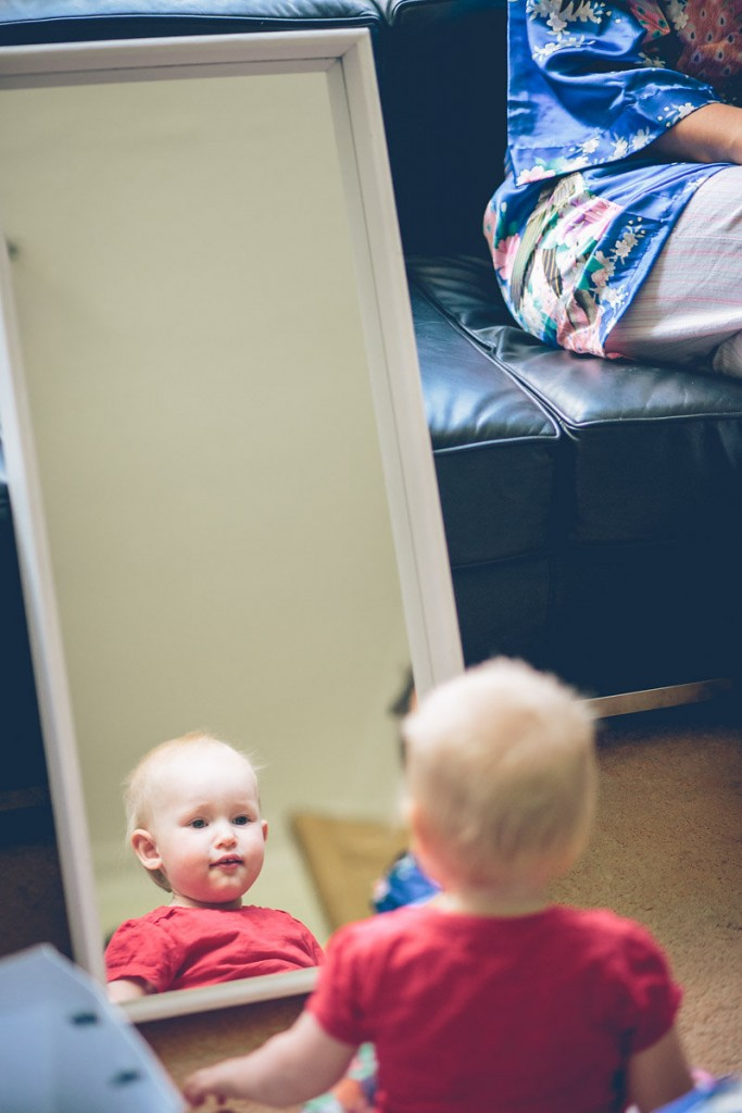 Child looking at reflection