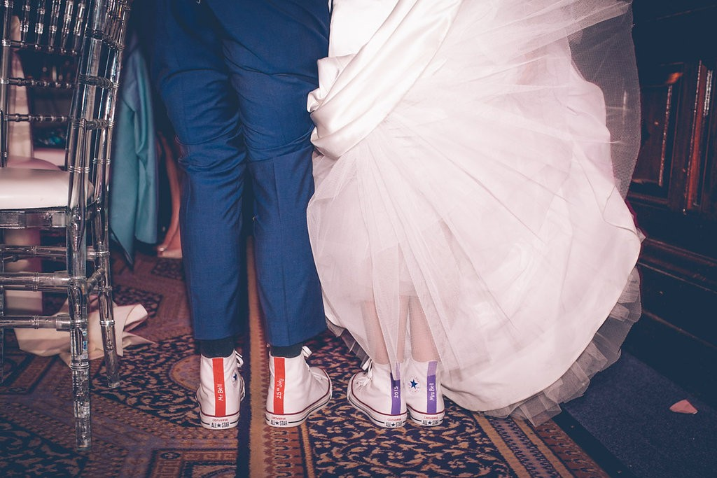 Bride and groom wearing matching converse