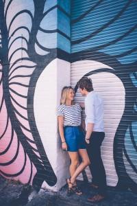 Couple against graffiti wall