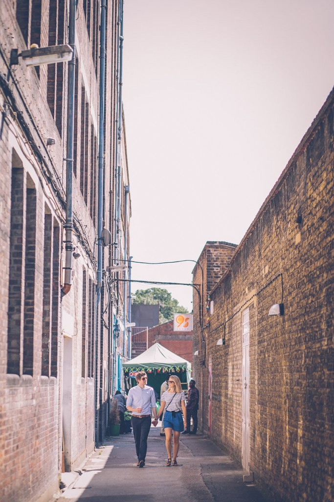 Couple walking down narrow street