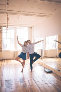 Couple dancing infront of mirrors