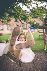 Flower girl on swing