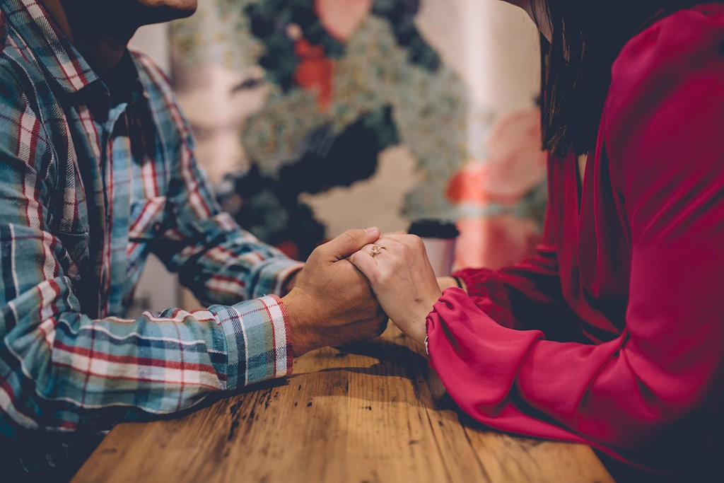 Engagement shoot holding hands