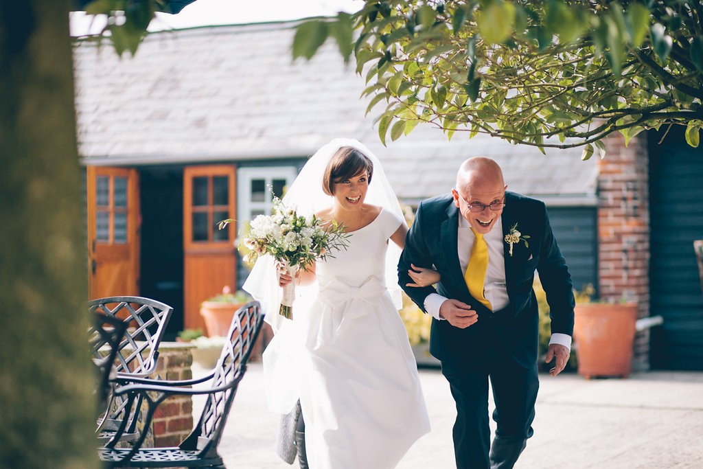 Bridesmaid and father walking to ceremony