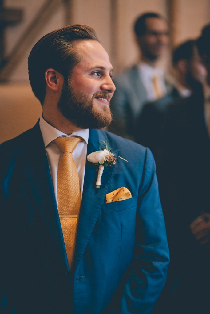 Groom waiting at front of aisle