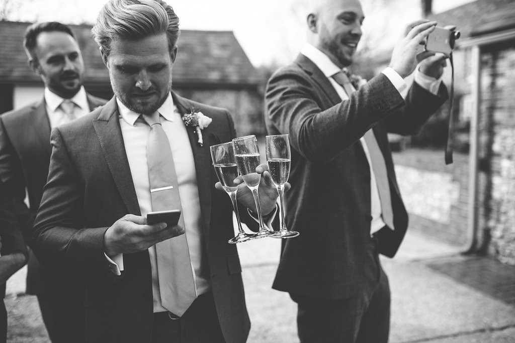 Groom with drinks in hand