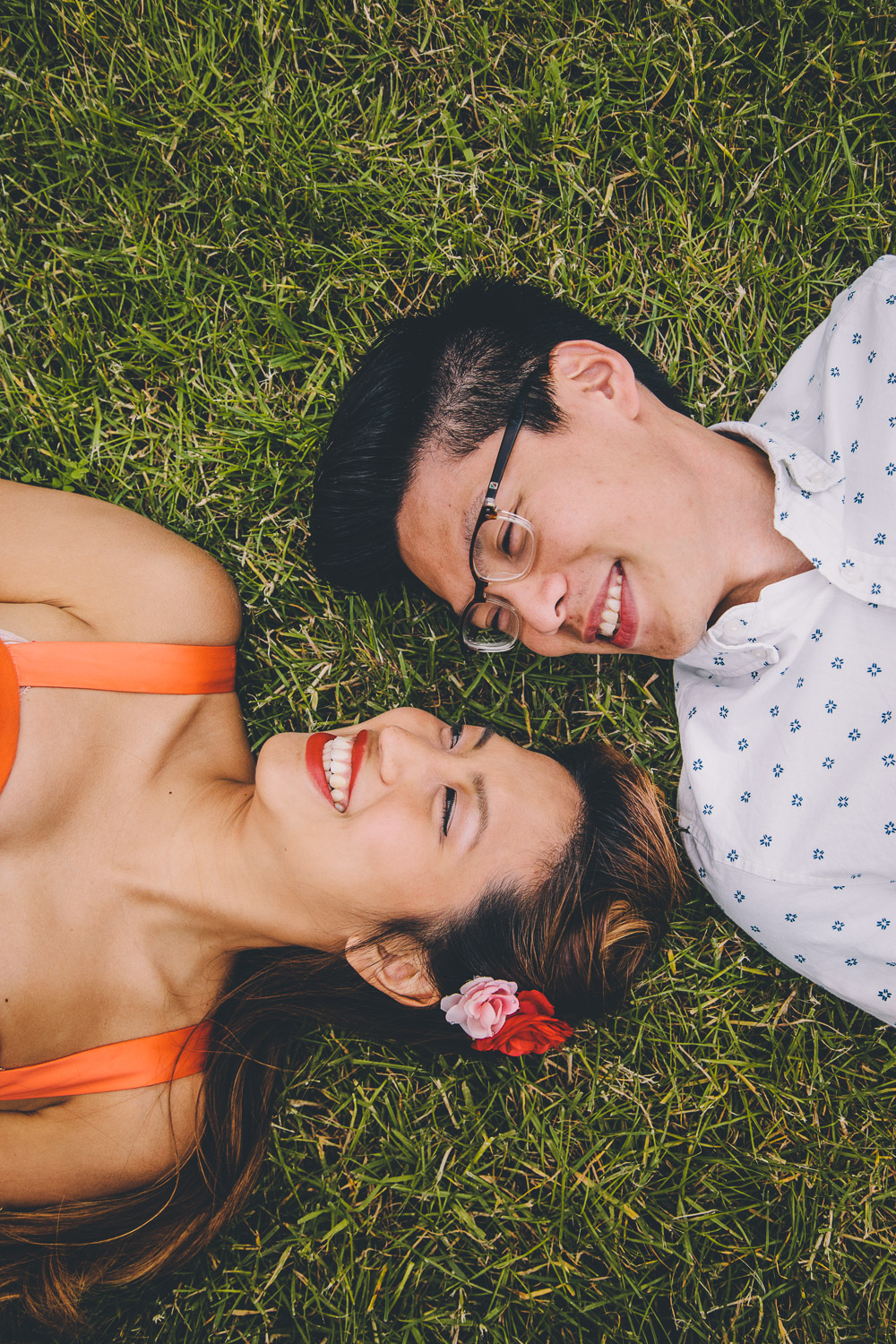 engagement shoot couple laying in grass