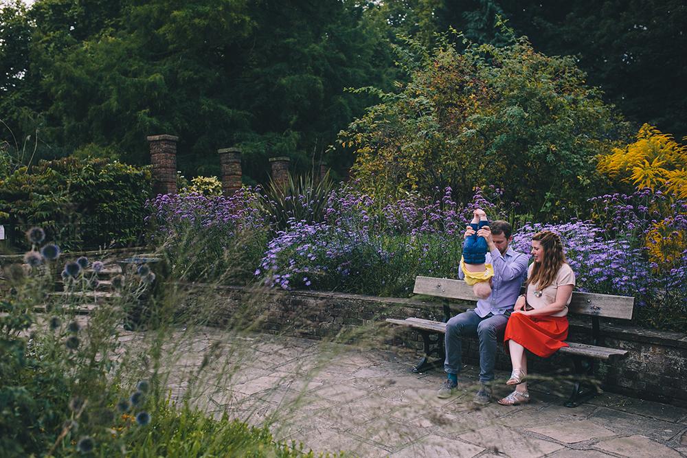 family photoshoot on park bench