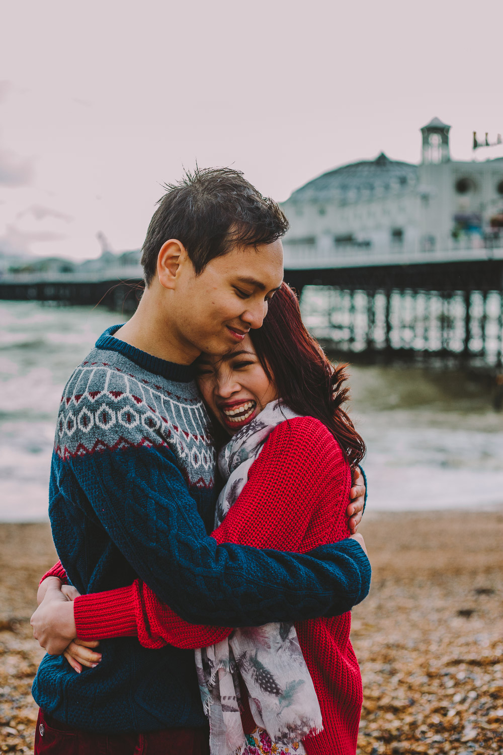 engagement shoot couple embracing on beach