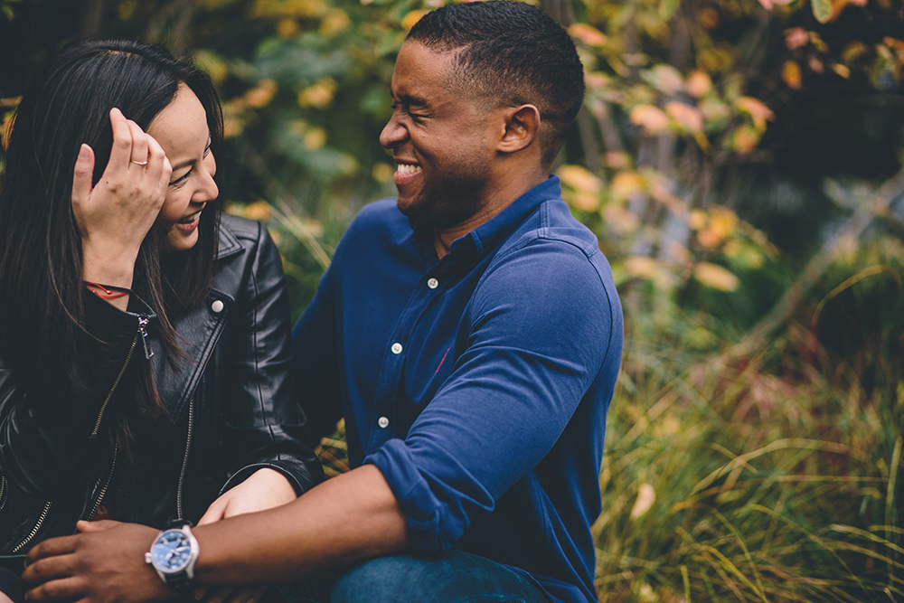 engagement shoot couple laughing in park