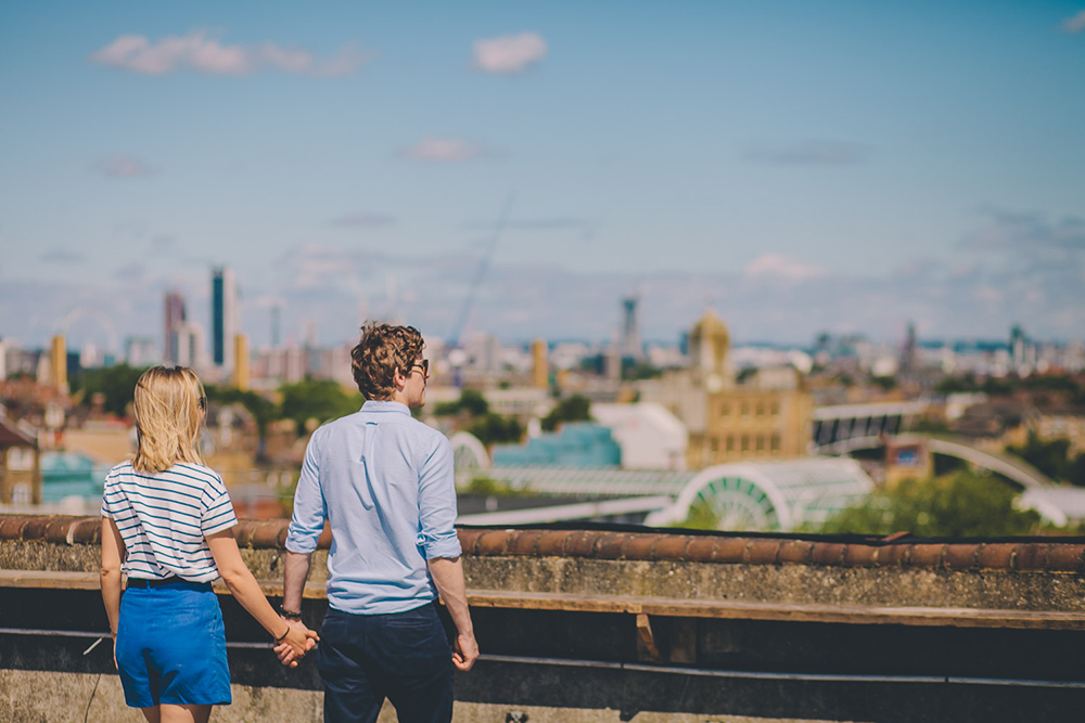 engagement shoot couple looking at london skyline
