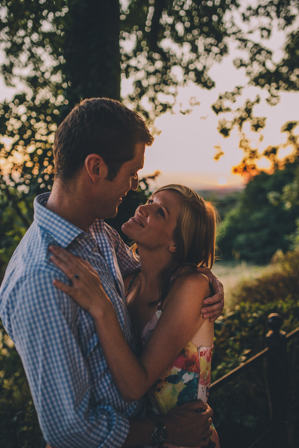 engagement shoot couple hugging at sunset