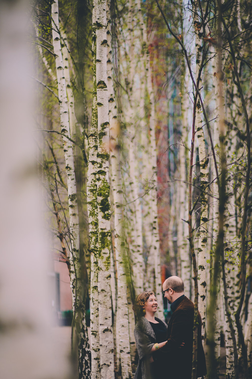 engagement shoot couple in trees