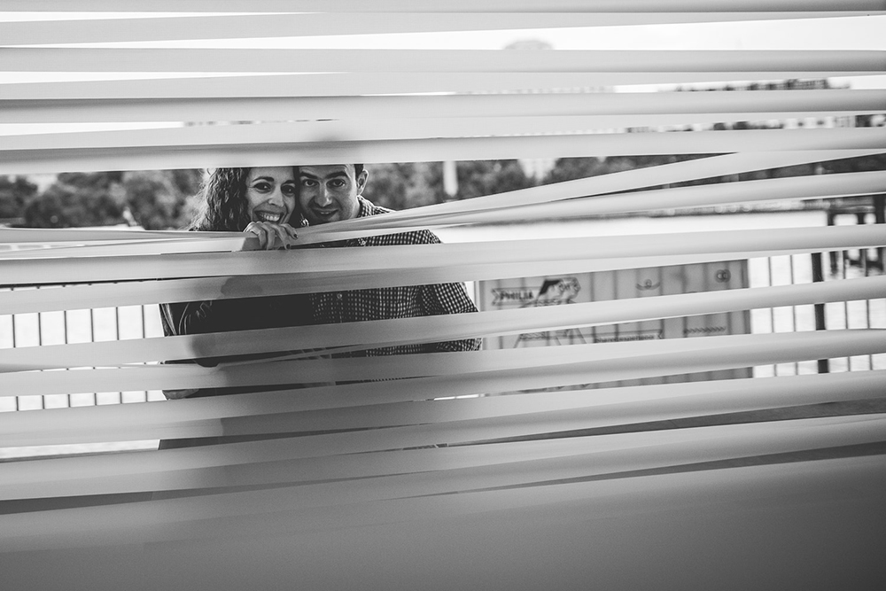 engagement shoot couple peeking in window