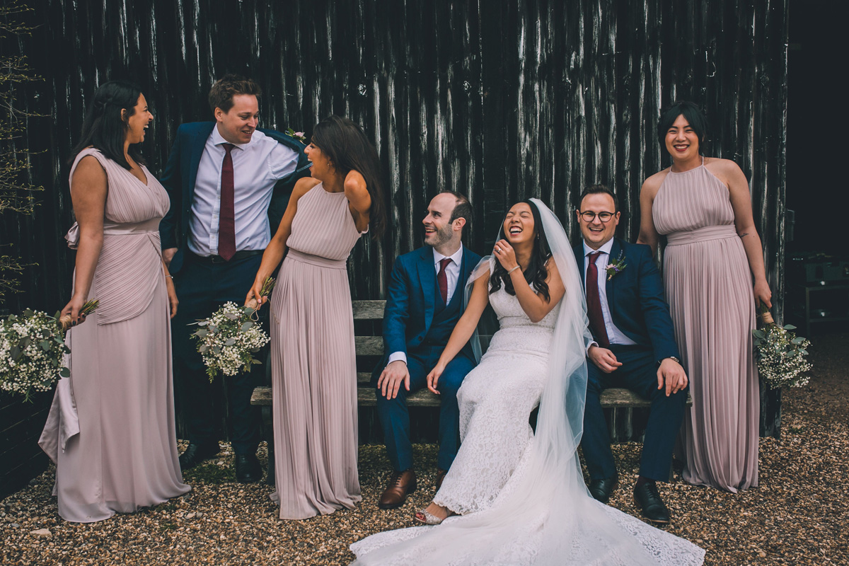 Natural wedding photography laughing bridal party
