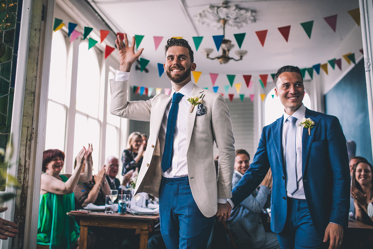 Natural wedding photography gay wedding couple holding hands