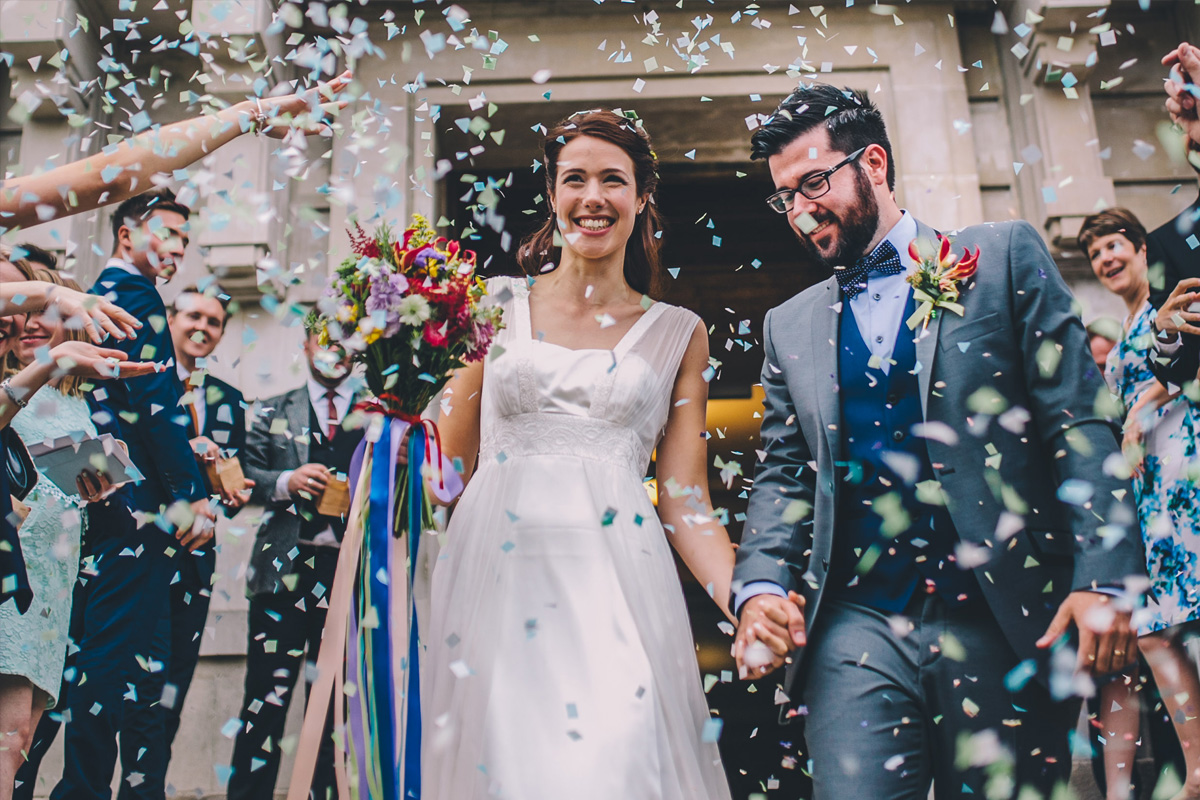 Natural wedding photography confetti outside town hall