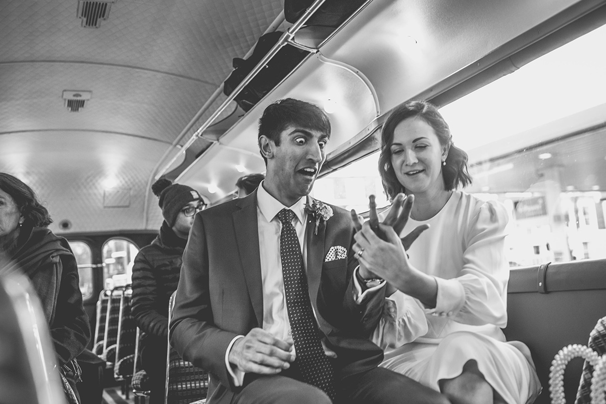 natural wedding photographer london bus surprised groom