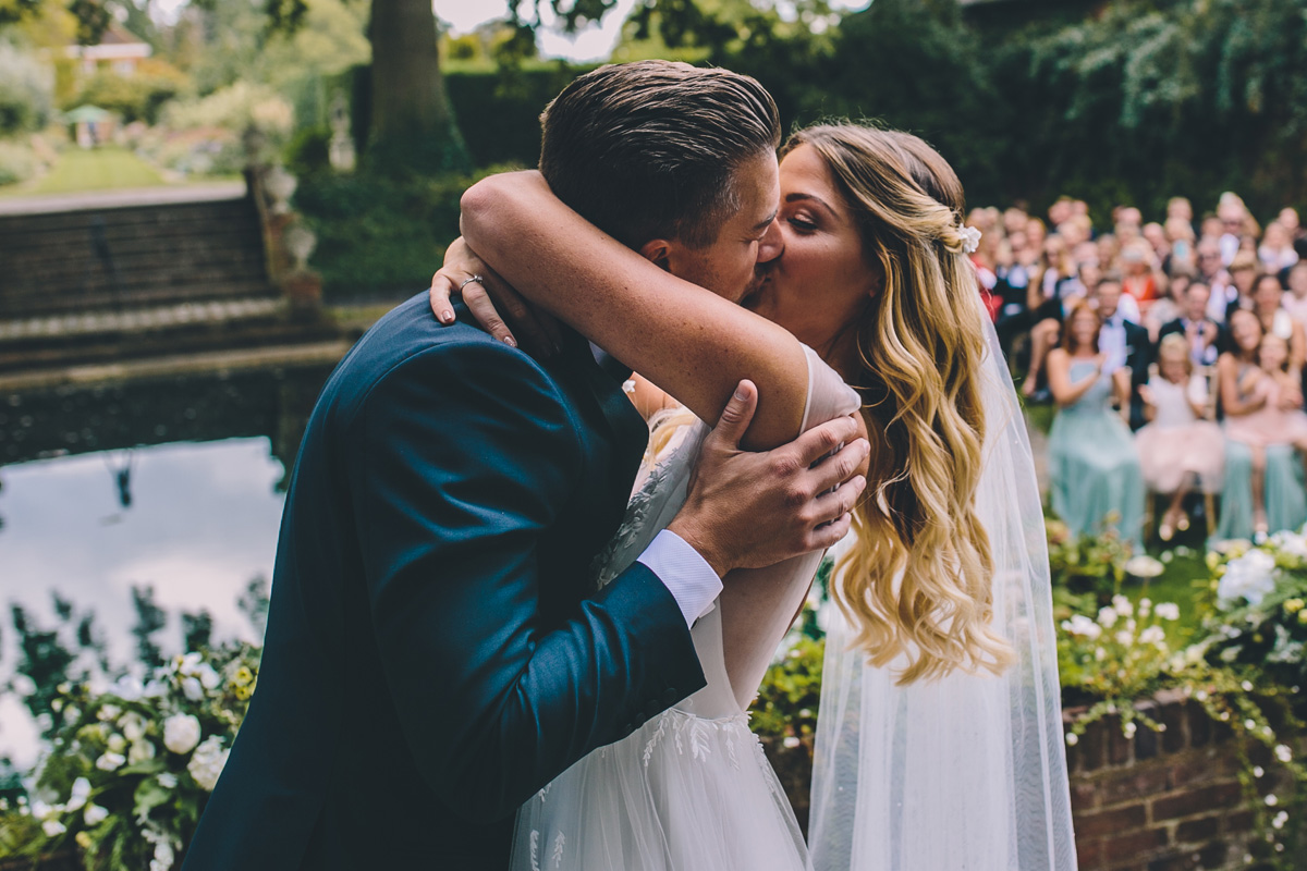 natural wedding photographer micklefield hall first kiss