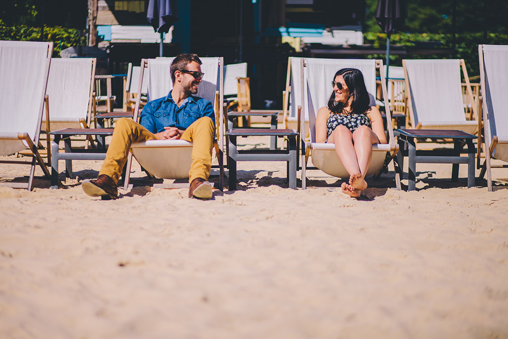 engagement shoot couple in deckchairs on beach