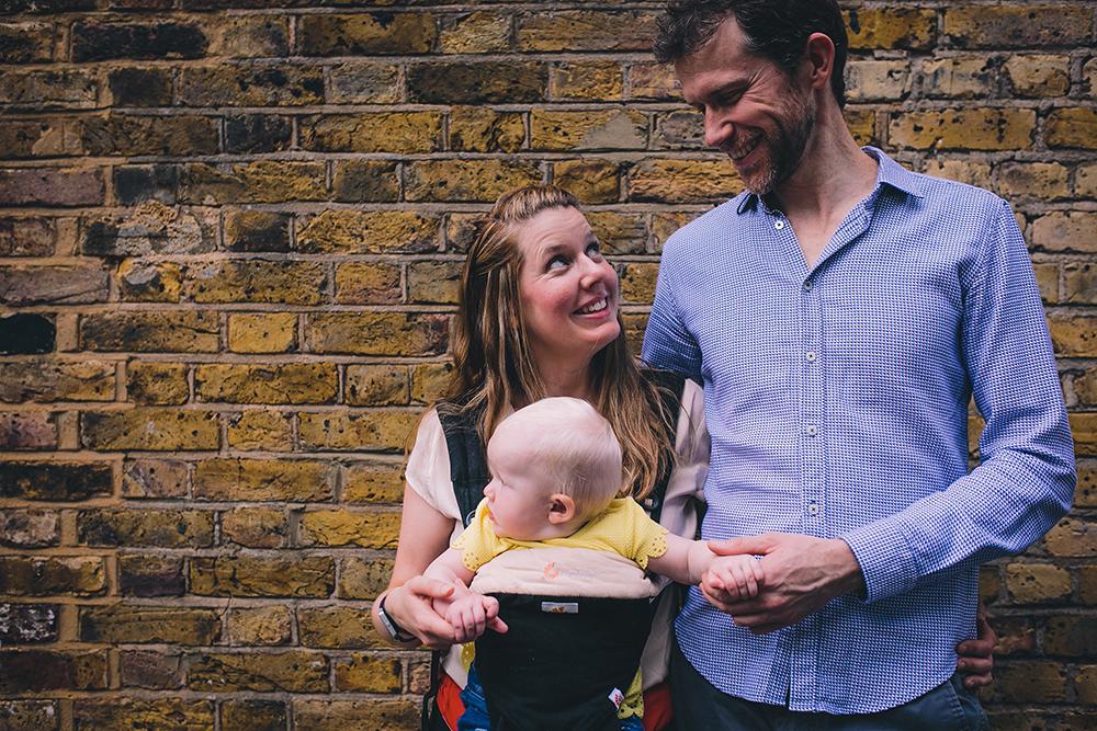 family photoshoot against brick wall
