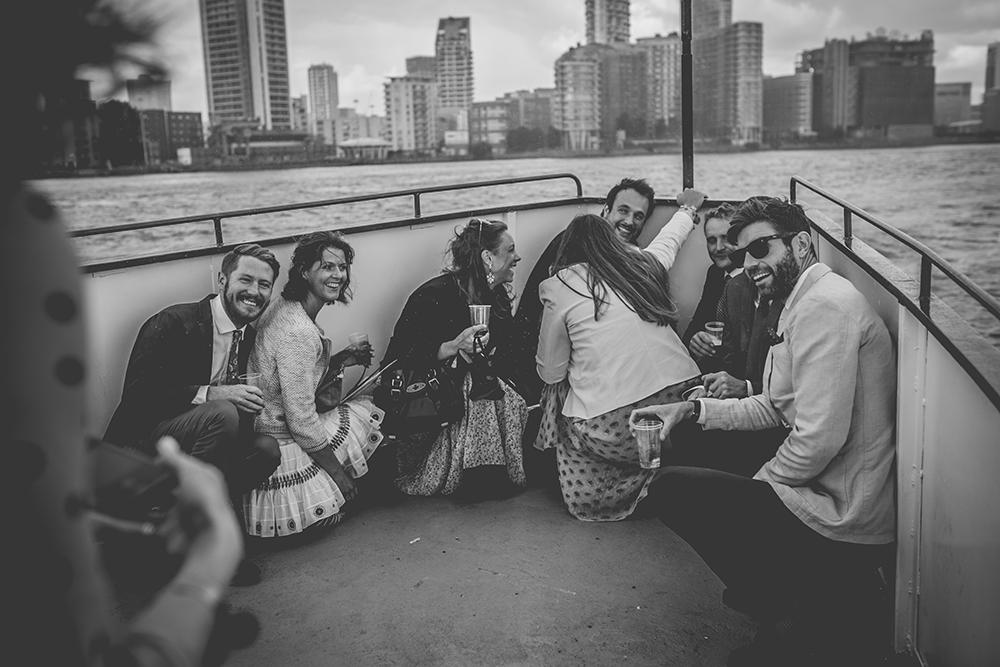guests on boat trinity buoy wharf urban wedding