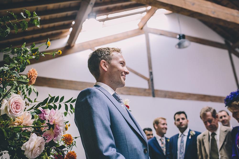 groom waiting for bride trinity buoy wharf urban wedding