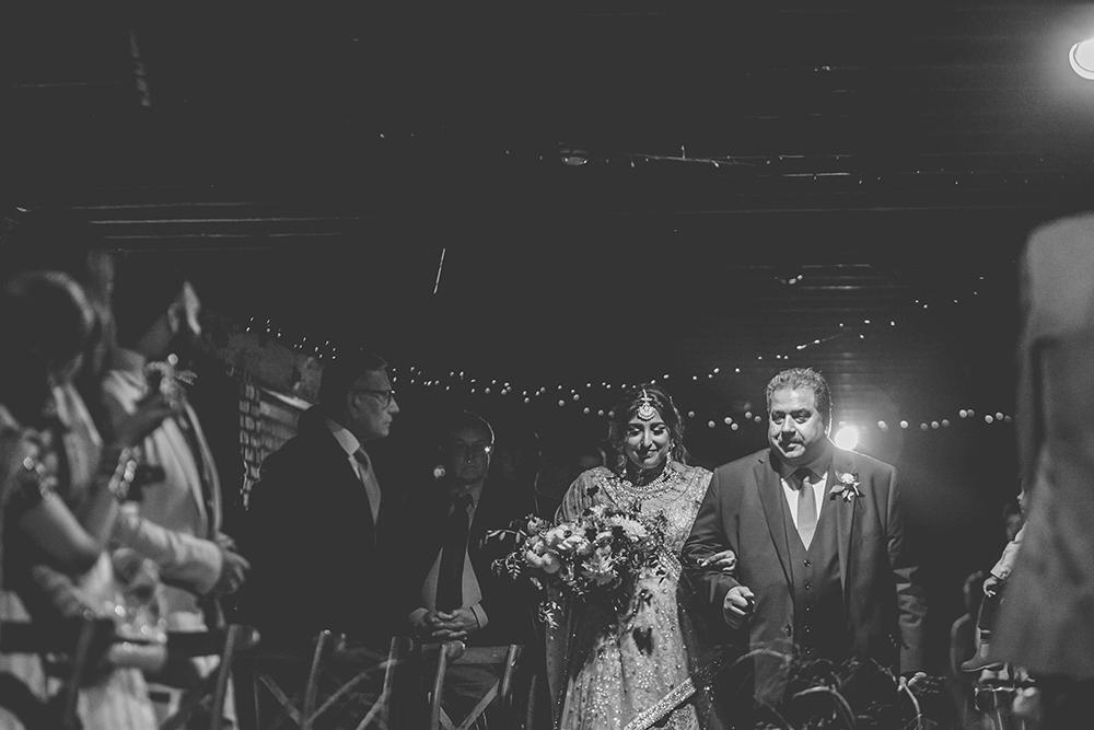 bride entering trinity buoy wharf indian wedding