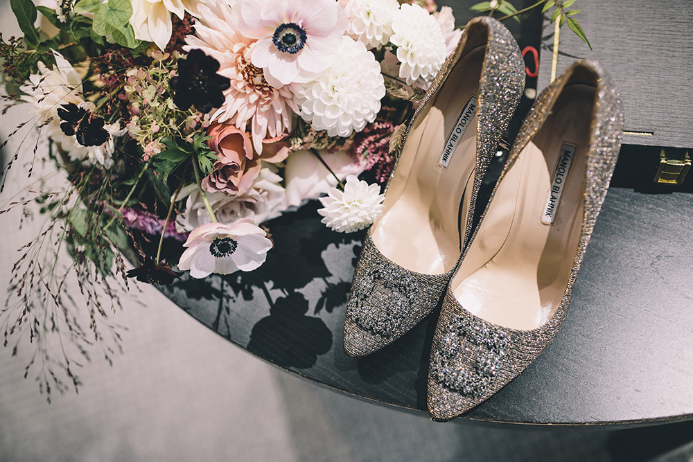 shoes and bouquet trinity buoy wharf indian wedding