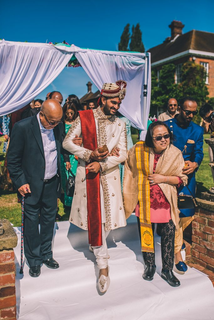groom entering indian ceremony micklefield hall multicultural wedding