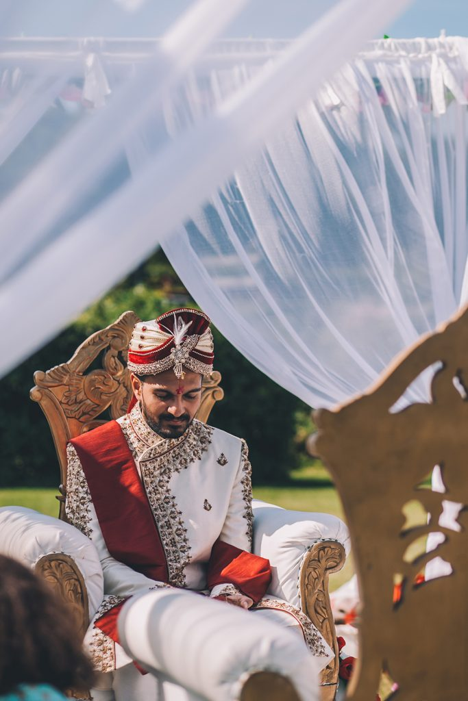 groom under mandap micklefield hall multicultural wedding