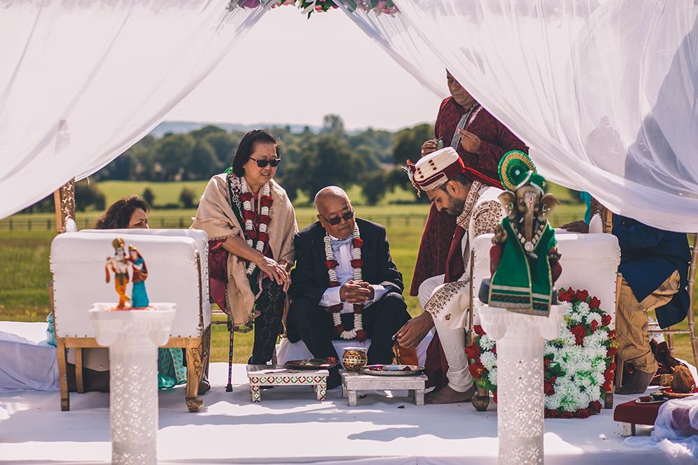 groom in mandap micklefield hall multicultural wedding