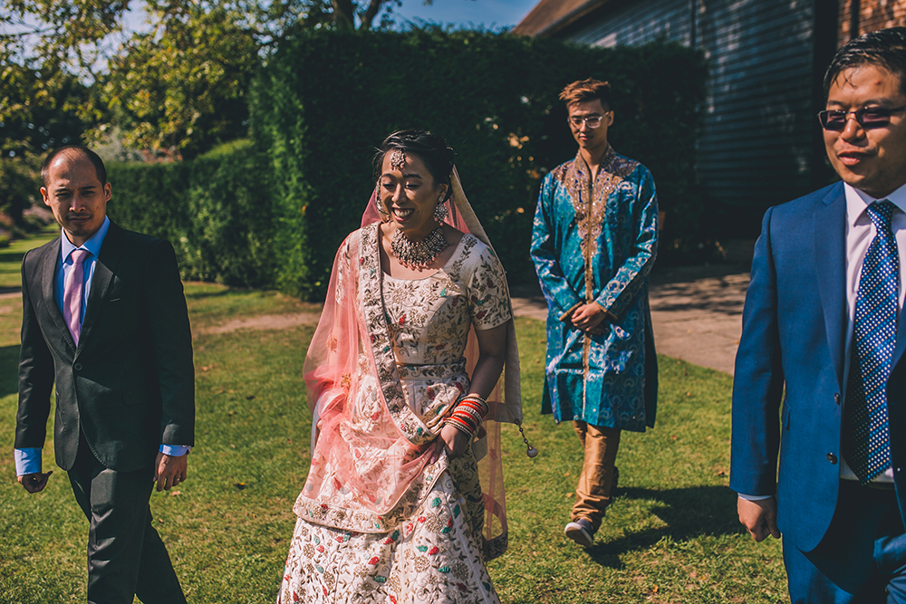 bride entering indian ceremony micklefield hall multicultural wedding