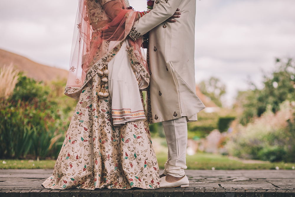 bride and groom micklefield hall multicultural wedding