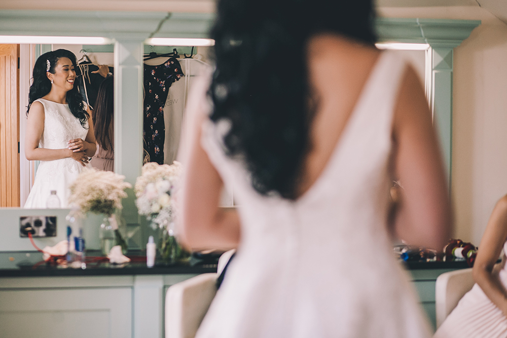 bride in mirror micklefield hall multicultural wedding