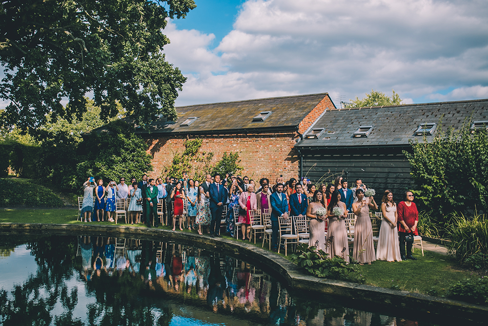 guests in ceremony micklefield hall multicultural wedding