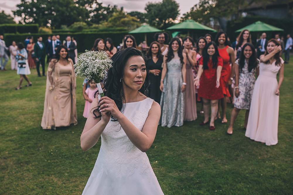 throwing bouquet micklefield hall multicultural wedding