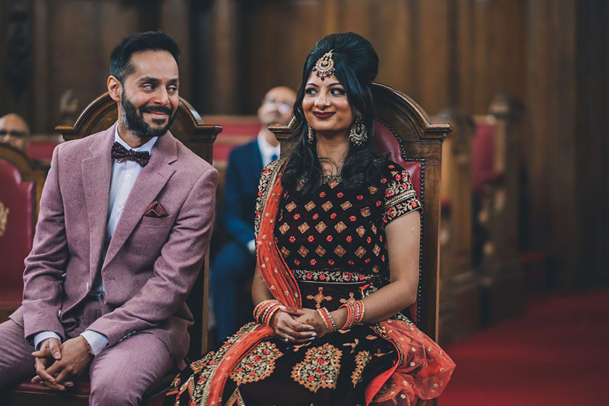 couple smiling in ceremony indian wedding photography