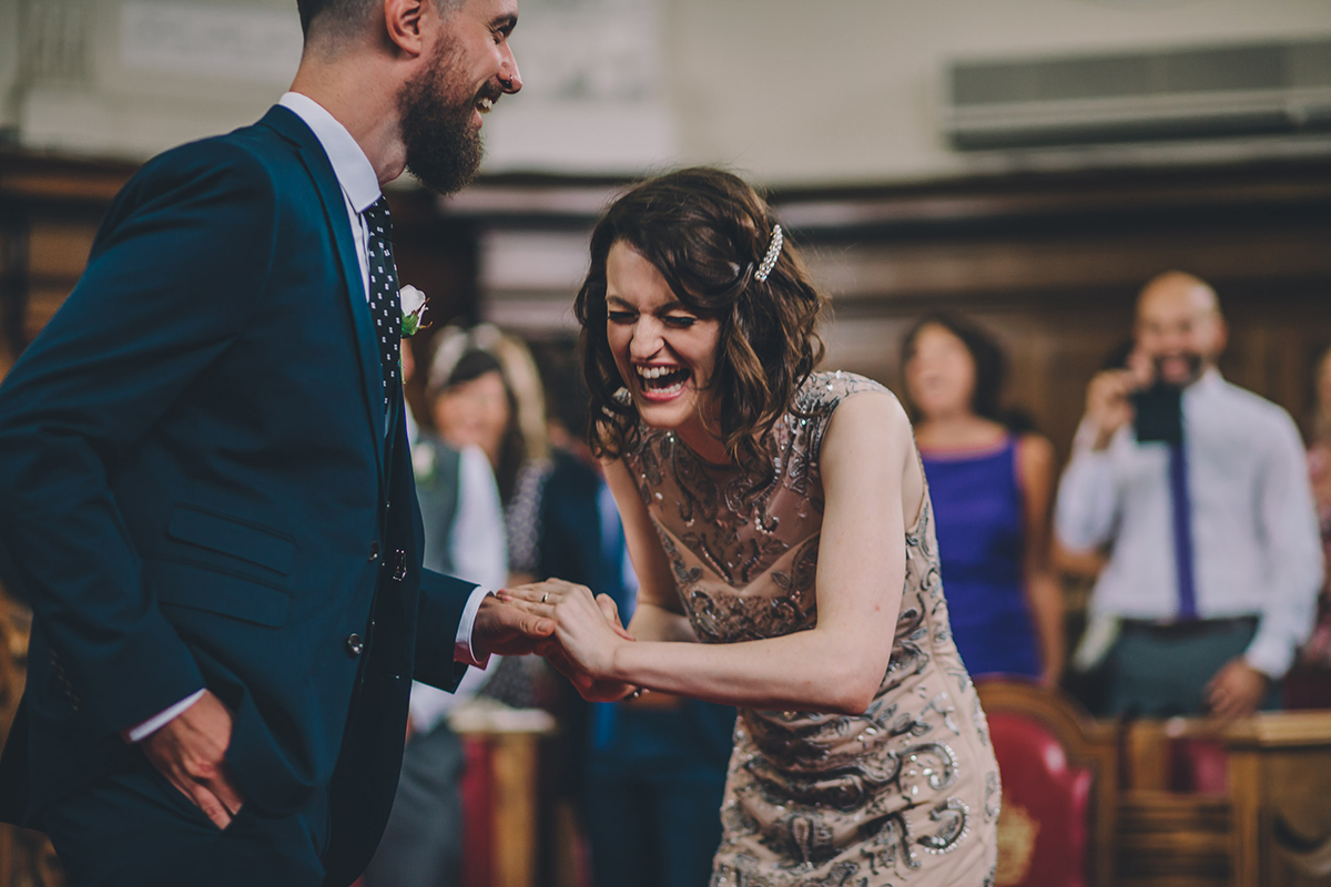 bride laughing in ceremony islington wedding photography